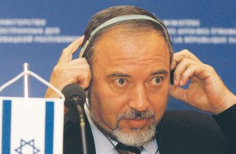 Lieberman with headphones 311 (photo credit: AP)
