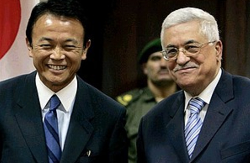 abbas and japanese fm 29 (photo credit: AP)