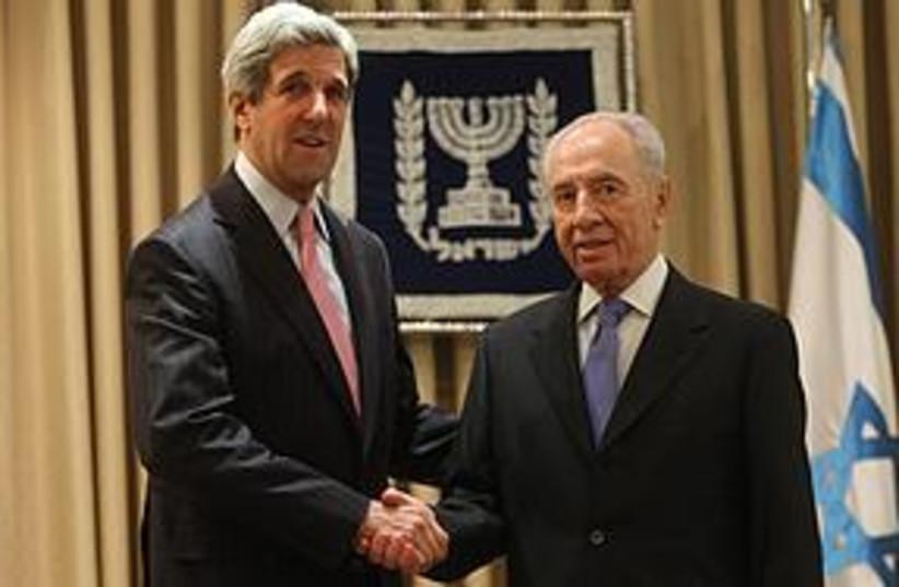 Peres with Senator John Kerry [file] (photo credit: Jini Agency)