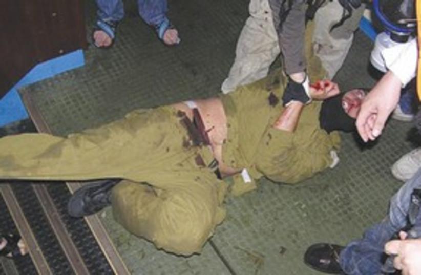 injured soldier on flotilla 311 (photo credit: Courtesy: IHH)