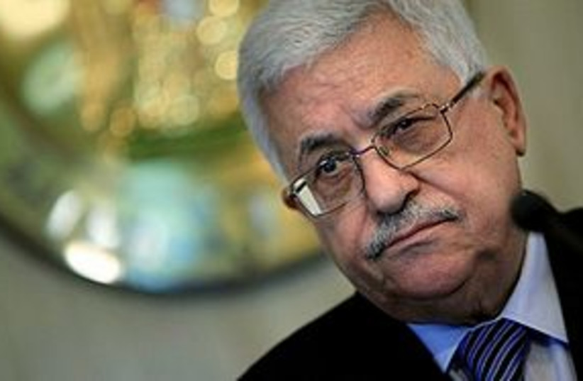 Abbas alone (photo credit: ASSOCIATED PRESS)