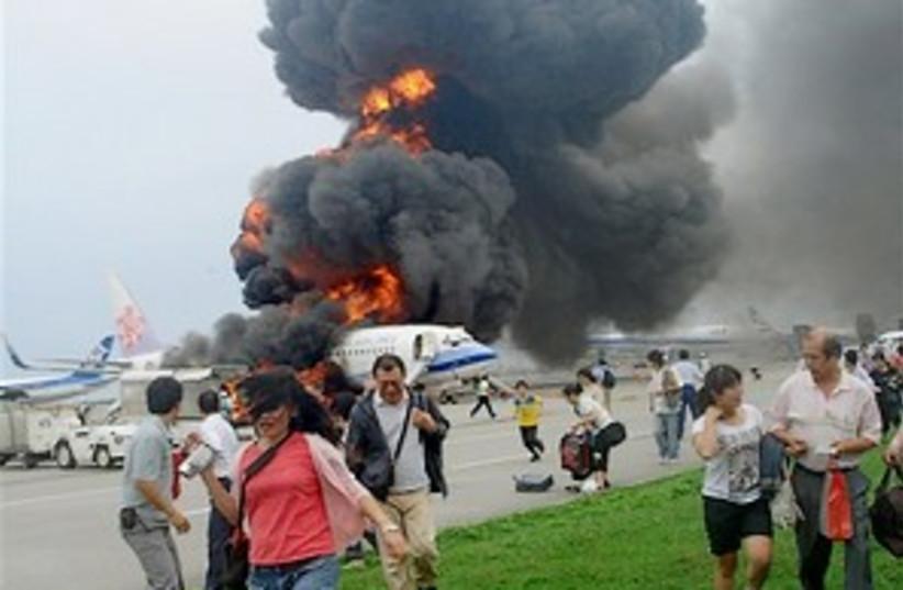 japan jet blast 298.88 (photo credit: AP)
