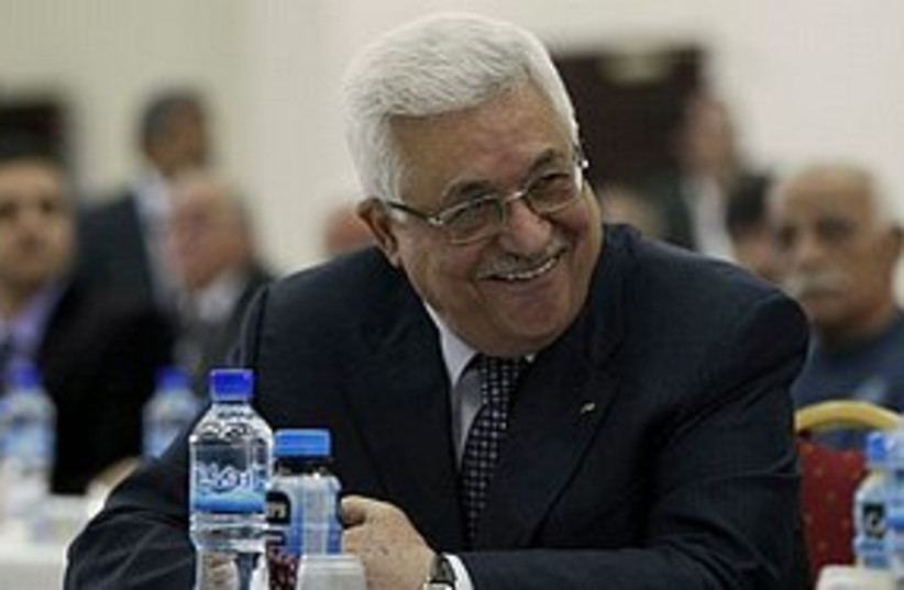 Abbas smiling (photo credit: ASSOCIATED PRESS)