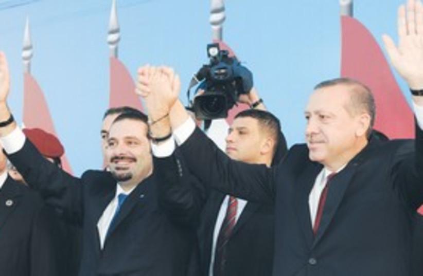 Saad Hariri,  Erdogan waving 311 (photo credit: Ahmad Omar/AP)