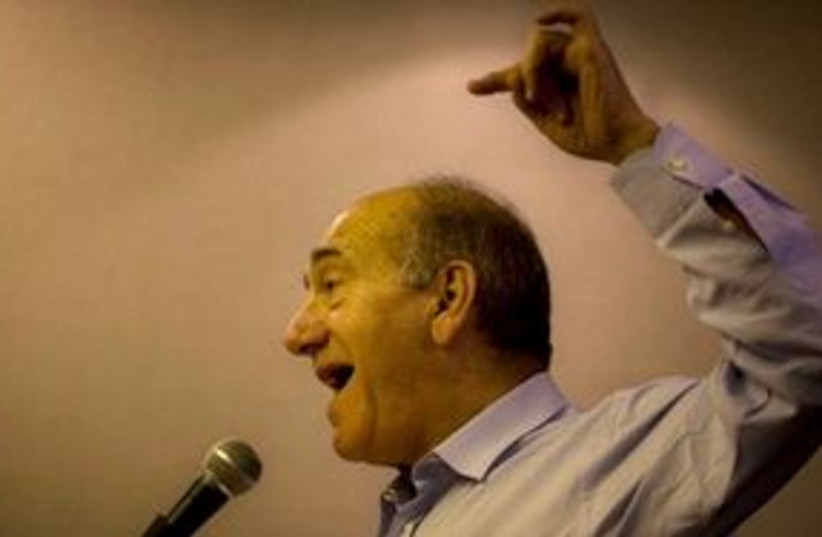 Olmert speaks 311 (photo credit: Associated Press)