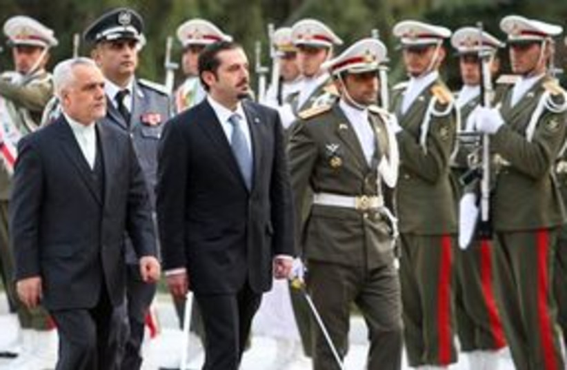 Lebanese PM Hariri and Iranian VP Rahim 311 AP (photo credit: AP)