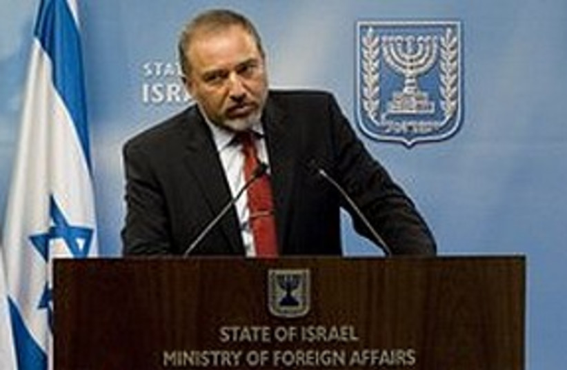 Lieberman growling at podium 311 AP (photo credit: Associated Press)