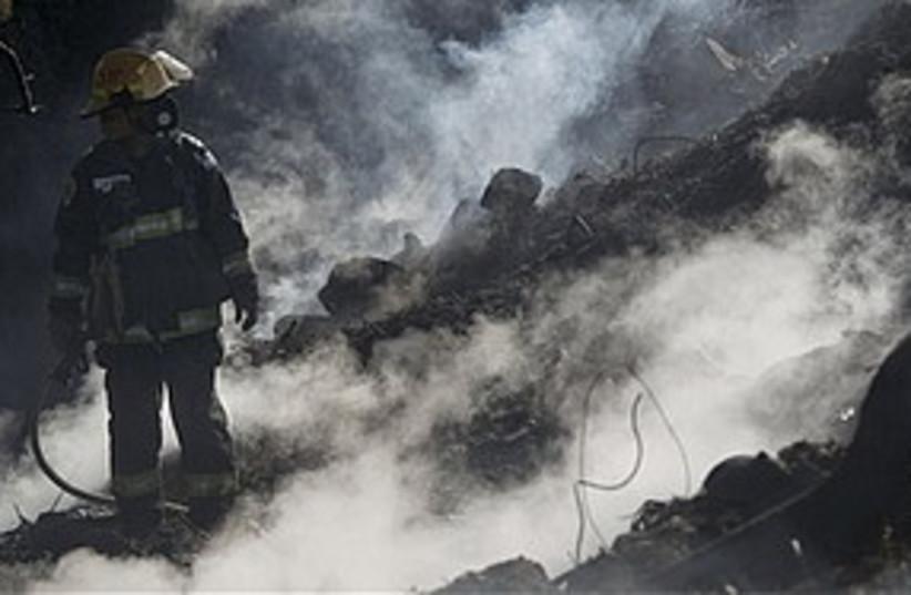 Firefighter carmel 311 ap (photo credit: Associated Press)