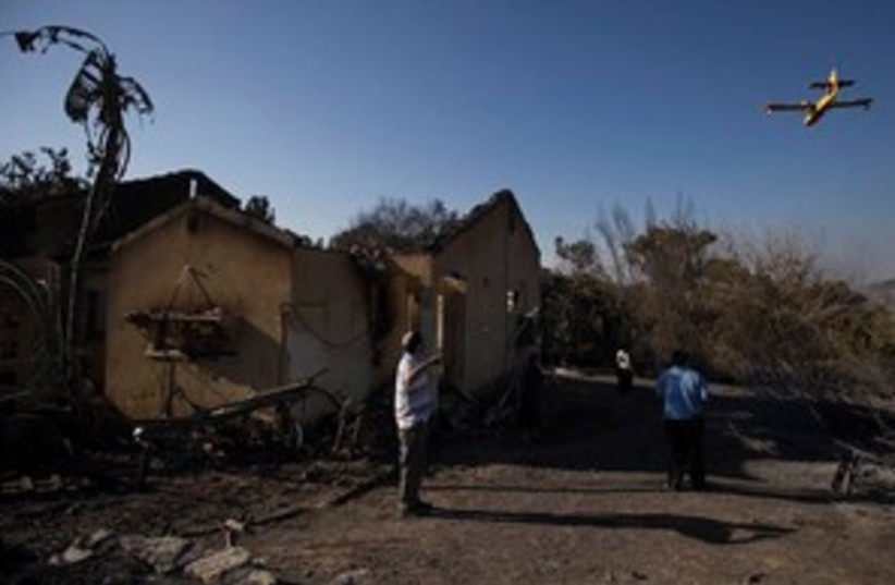 311_Burn out remains of Yemin Orde (photo credit: Associated Press)