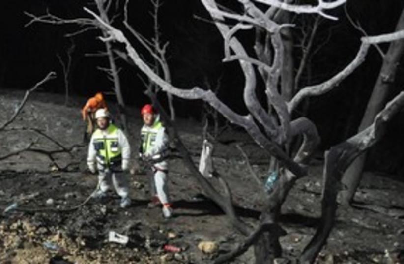 311_zaka in fire aftermath (photo credit: Aharon Baruch Leibovitch)