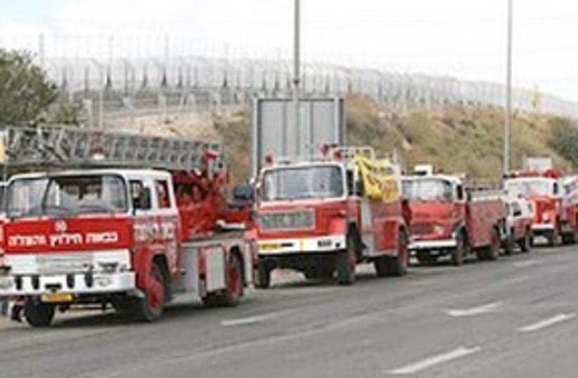 Fire trucks 311 (photo credit: Ariel Jerozolimski)