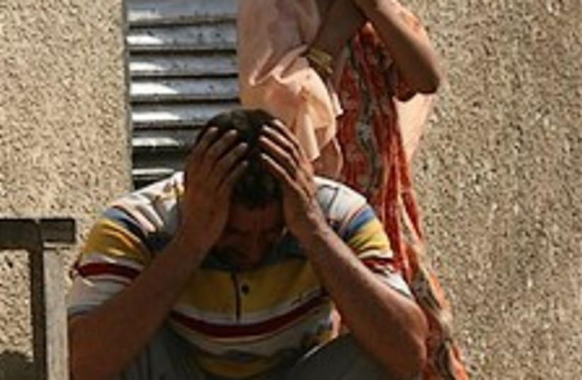 Iraq weeping  224.88 (photo credit: AP)