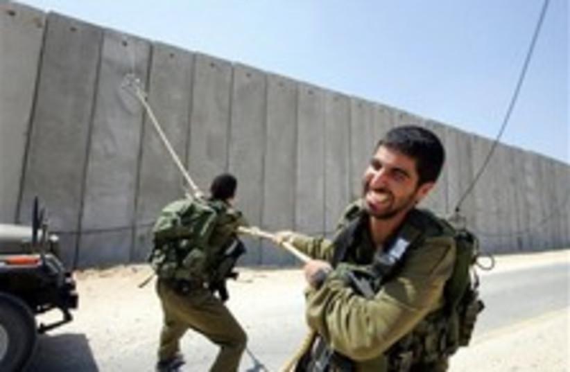 gaza fence troops 224.88 (photo credit: AP)