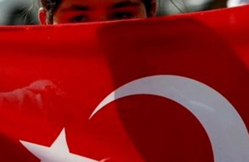 Child holding Turkish flag 311 AP (photo credit: AP)
