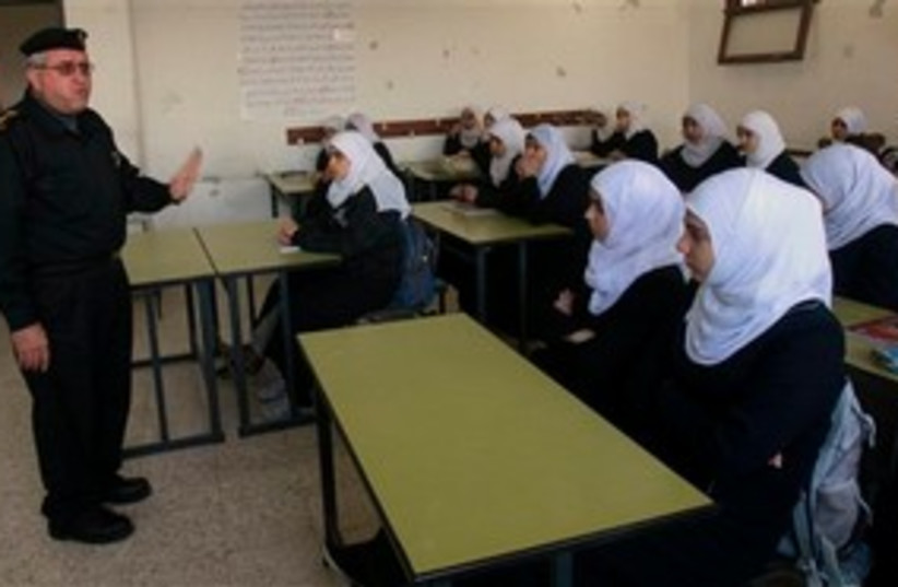 Hamas official with Gazan schoolgirls 311 AP (photo credit: AP)