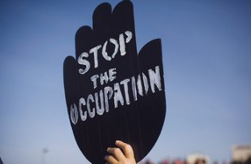 Stop the occupation sign 311 (photo credit: AP)