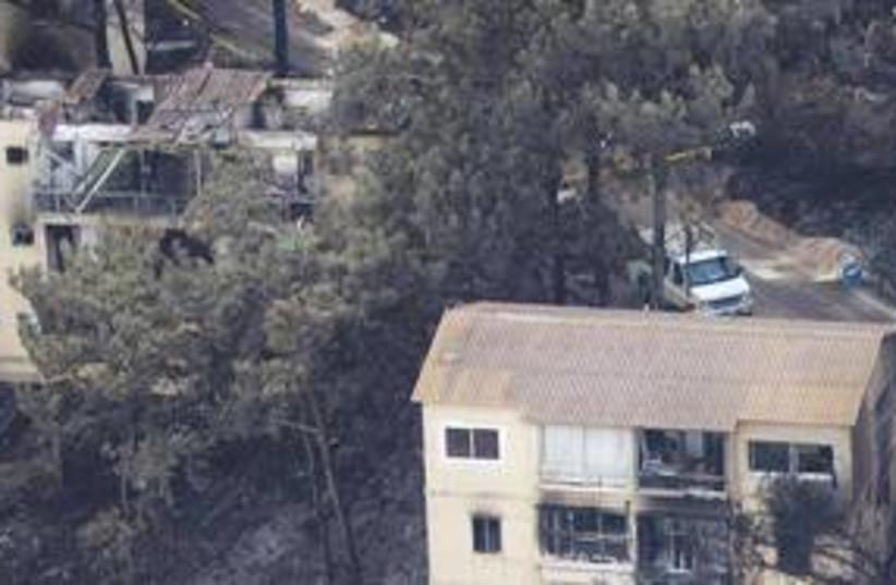 Burned homes 311 (photo credit: AP)