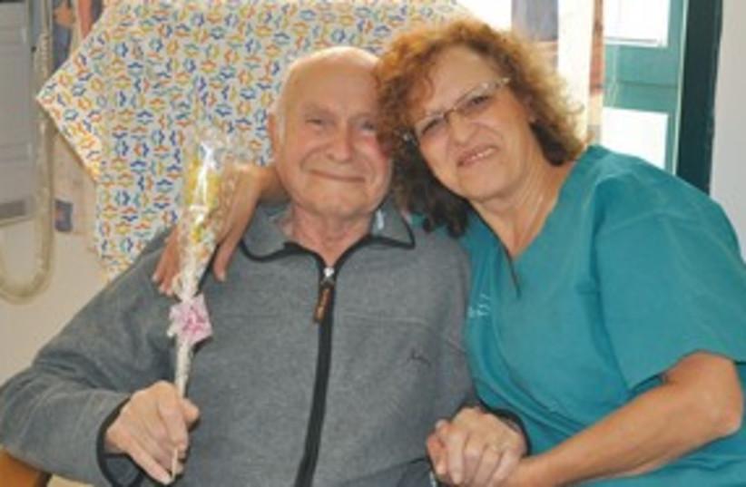 Nurse Josiann Shoshani hugs 80yr old  Avraham Rosenberg 311 (photo credit: Courtesy)