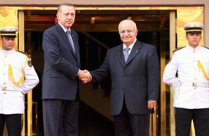 Erdogan, Syrian counterpart shaking hands 311 (photo credit: AP Photo/Burhan Ozbilici)
