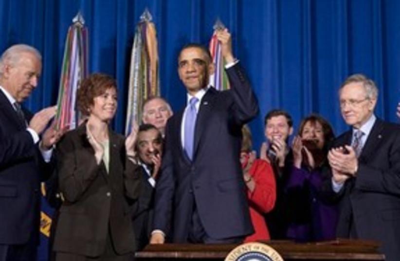 Obama thumbs up smiling 311 (photo credit: AP Photo/Evan Vucci)