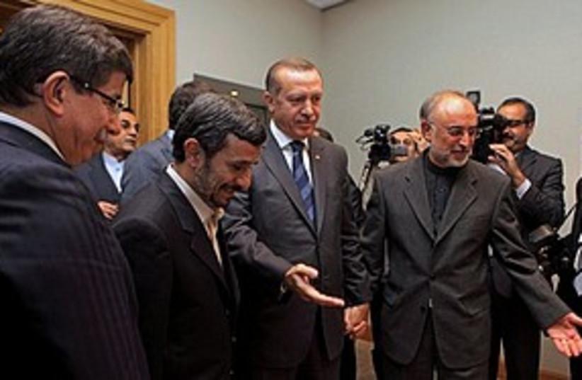 Erdogan Ahmadinejad Salehi in Istanbul 311 (photo credit: Associated Press)