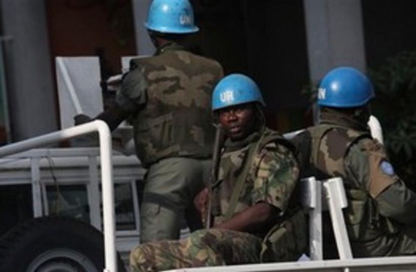 UN forces patrol in Ivory Coast (photo credit: AP Photo/Sunday Alamba)