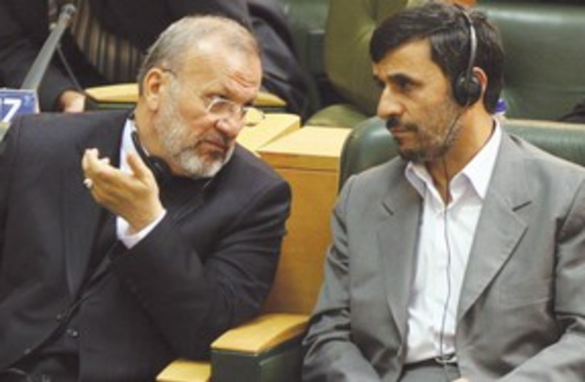 Ahmadinejad, Manouchehr Mottaki talking 311 (photo credit: AP)