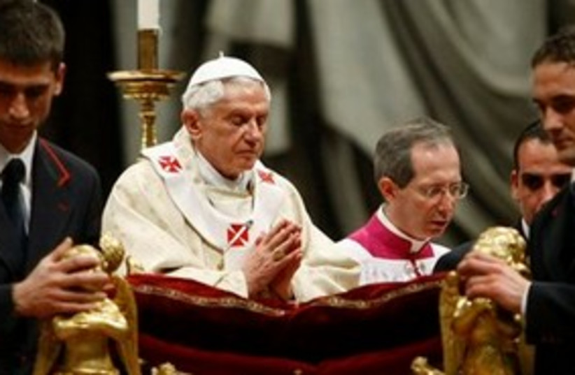 Pope, eyes closed, praying at Christmas 311 (photo credit: AP Photo/Andrew Medichini)