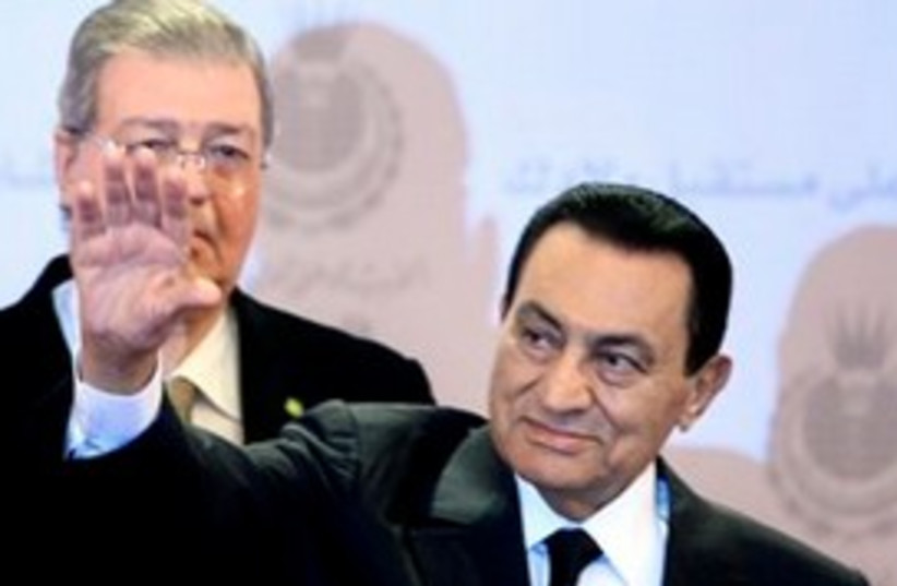 Mubarak waving, kind of smiling 311  (photo credit: AP Photo/Amr Nabil)