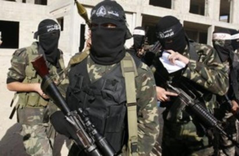 Hamas masks news conference Gaza 311 (photo credit: AP)