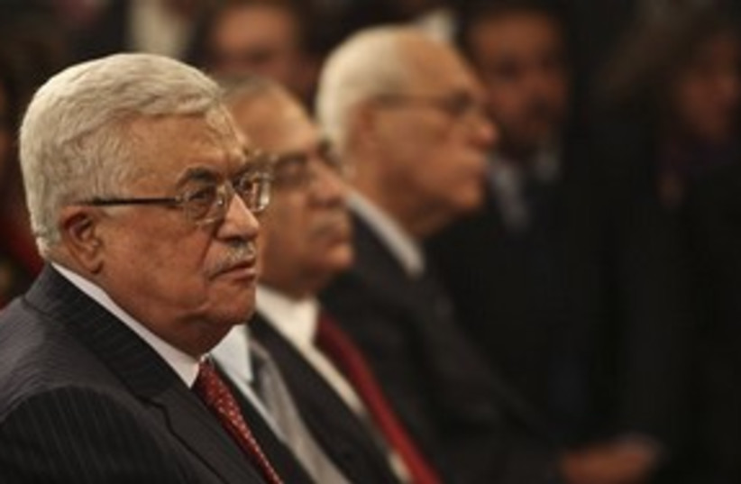 Abbas, Fayyad at Bethlehem mass 311 AP (photo credit: AP)