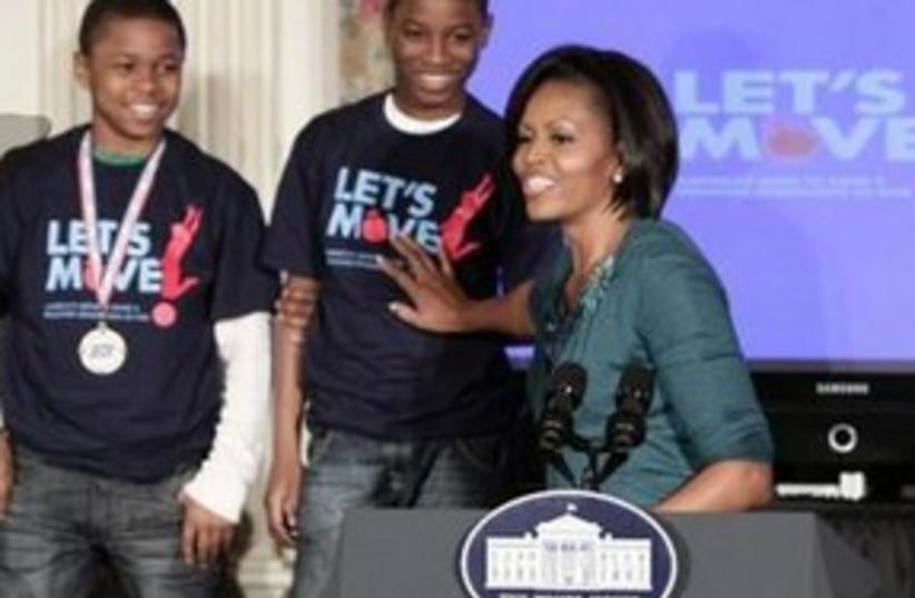 Michelle Obama Move it (photo credit: Associated Press)