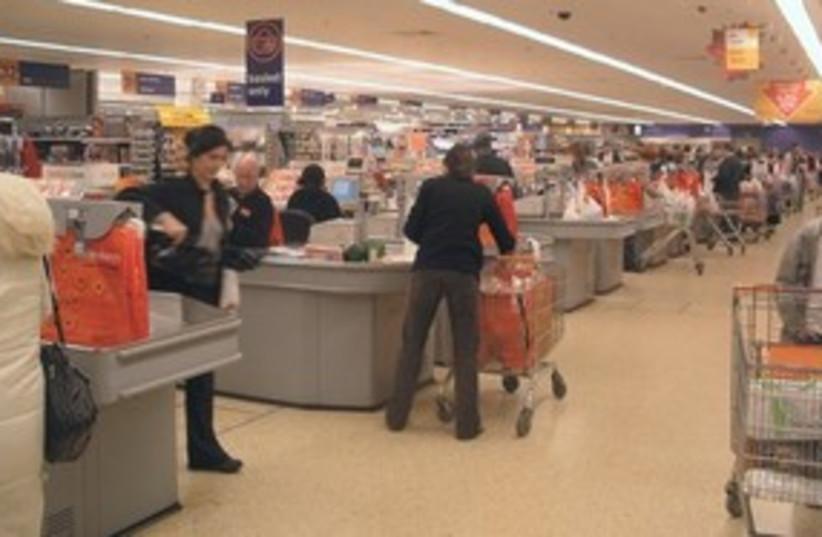 Supermarket shopping 311 AP (photo credit: AP)