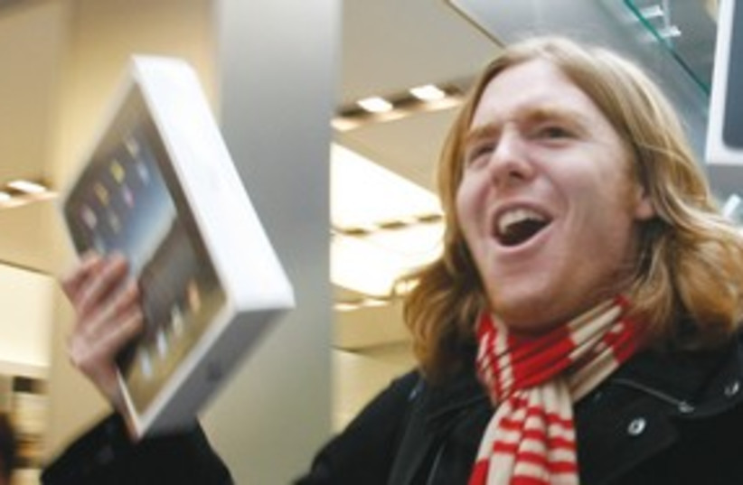 happy guy holding ipad 311 (photo credit: AP)