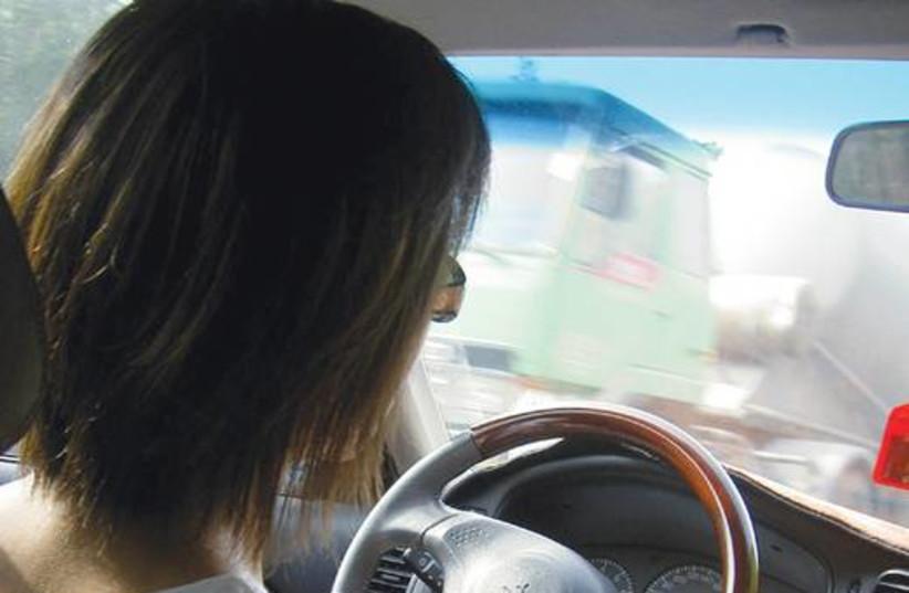 Woman driving 521 (photo credit: Illustrative photo)