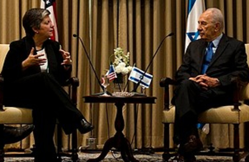 napolitano and peres (photo credit: ASSOCIATED PRESS)