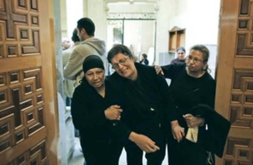 grieving egyptians_311 (photo credit: ASSOCIATED PRESS)