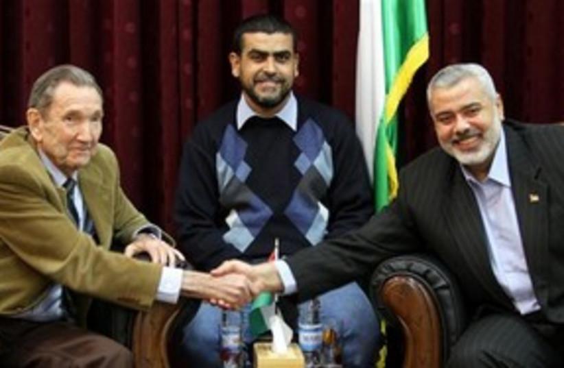 Ramsey Clark with Haniyeh 311 AP (photo credit: AP)
