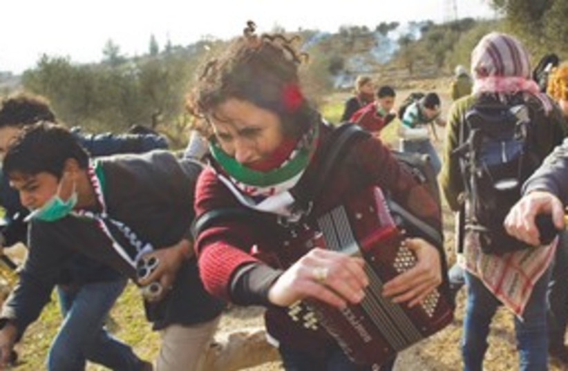 Demonstrators tear gas Bil'in 311 AP (photo credit: AP)