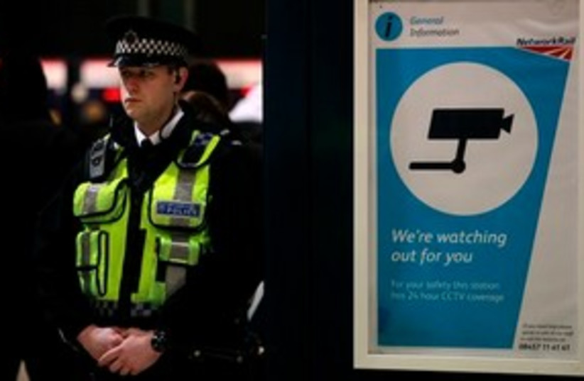 "British police at airport ""watching you"" 311 AP (photo credit: AP)"