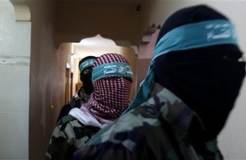 Masked Hamas officials press conference Gaza 311 AP (photo credit: AP)
