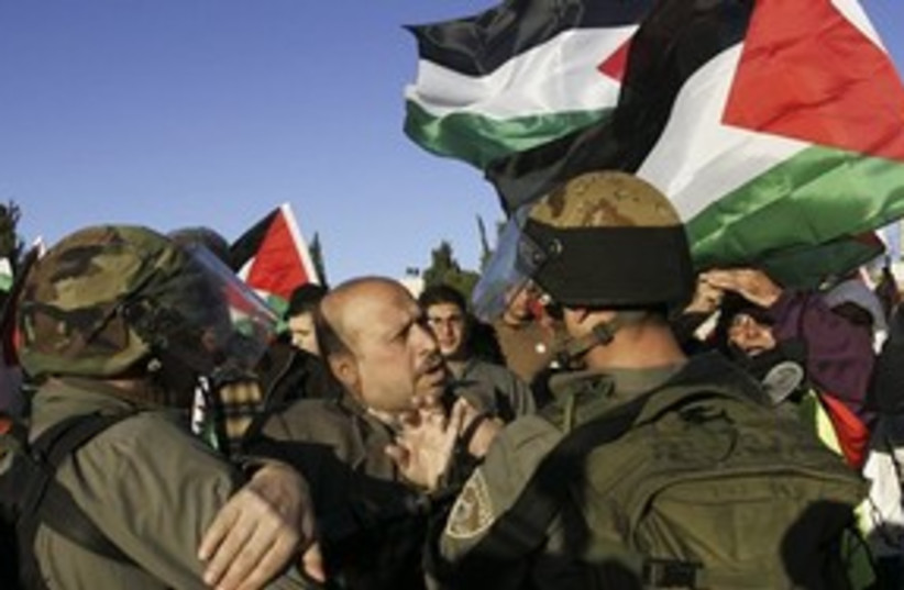 IDF soldiers and Palestinian at protest near Ramallah 311 (photo credit: AP)