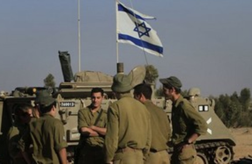 IDF troops with tank on Gaza border 311 AP (photo credit: AP)