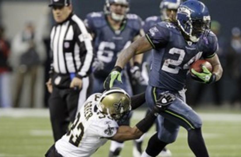 SEATTLE SEAHAWKS & New Orleans Saints 311 AP (photo credit: AP)