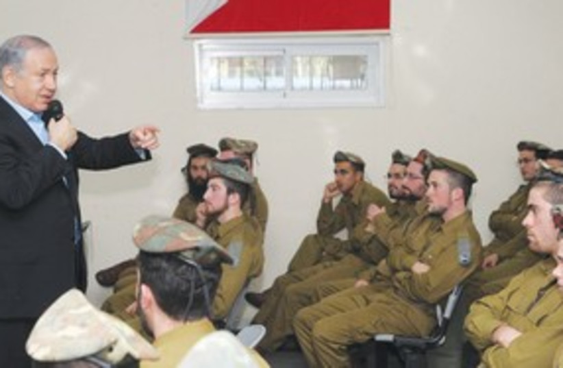 Netanyahu at nahal haredi base 311 (photo credit: Amos Ben-Gershom/GPO)
