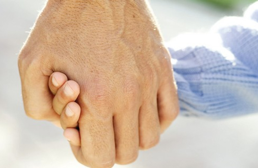 Holding hands 521 (photo credit: Courtesy.)
