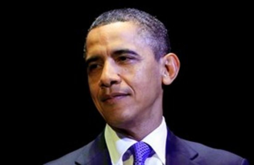 Obama looking smug with black background 311 (photo credit: AP Photo/Carolyn Kaster)