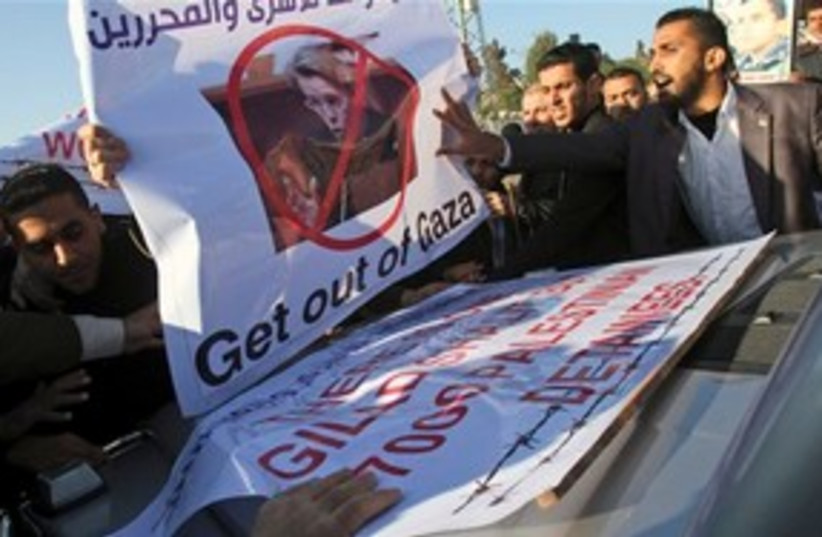 Palestinians protest French foreign minister 311 (photo credit: AP Photo/Adel Hana)