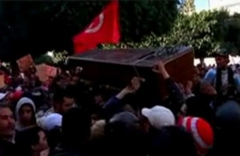 Tunisia protests coffin 311 (photo credit: Rueters Video)