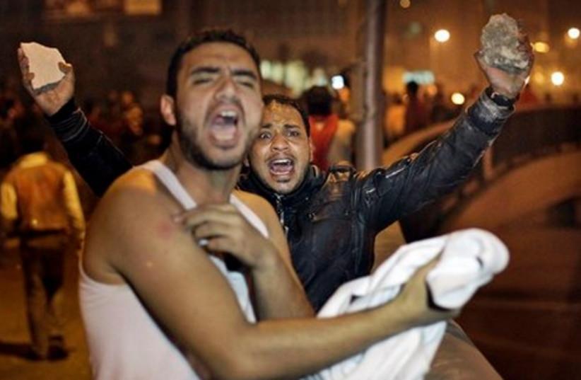 Egyptian protestor ready to pelt police (AP)